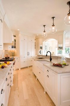 beautiful kitchen maybe a darker more rustic floor and cream colored cabinets. Kitchen