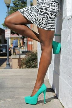 Teal heels and Aztec skirt.