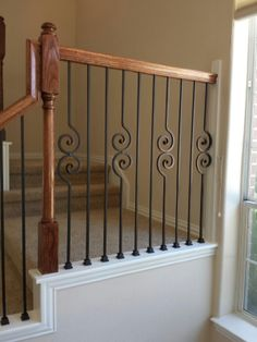 At this Houston residence, we took out the existing balusters and put in all new powder coated wrought iron pieces.  Using our PC18/1, PC18/2, and PC22/4 balusters, all in our Old World Copper color, we created a pattern that gives this stair and railing a classic profile that will be a pleasing addition to the entryway for many years to come.