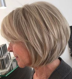 Dishwater Blonde Layered Bob Not quite ready to embrace your gray? No problem – the dirty blonde layered bob is one of those short haircuts for women over 60 that help you stay looking youthful and… Bob Haircuts For Women, Short Layered Haircuts, Layered Bob Hairstyles, Modern Haircuts, Cool Hairstyles, Layered Bobs, Wedding Hairstyles, Hairstyle Men, Formal Hairstyles