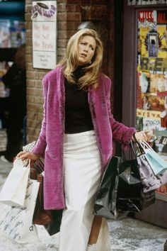 pink fur coat + black turtle neck + long white slit shirt + white ankle boots /Rachel Green