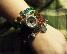 Brown and turquoise and green with a little silver mixed in make up this bohemian bracelet look.