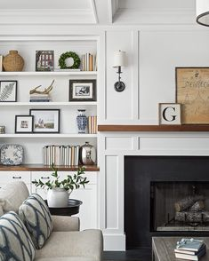 Home // Deko // Inneneinrichtung The fireplace features leathered black granite surround leathered b Fireplace Bookshelves, Fireplace Built Ins, Home Fireplace, Bookshelves Built In, Living Room With Fireplace, Fireplace Surrounds, Fireplace Design, Fireplace Ideas, Mantel Ideas