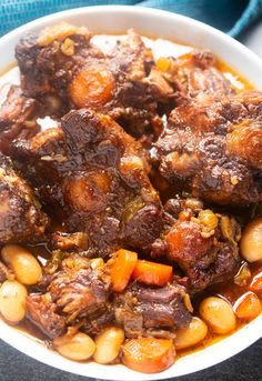 This Jamaican Oxtail recipe is the perfect Caribbean stew for dinner Delicious and tender oxtail and butter beans that is cooked to perfection Make it in the Instant Pot or any electric Pressure Cooker Stove top and slow cooker instructions also included Jamaican Cuisine, Jamaican Dishes, Jamaican Recipes, Jamaican Ox Tails Recipe, Jamaican Jerk Sauce, Jamaican Curry Chicken, Haitian Food Recipes, Oxtail Recipes Crockpot, Beef Recipes