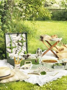 Cushions/ vintage blankets, cute little folded table - love the greens that match nature!