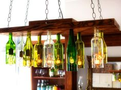 How to Make a Chandelier From Old Wine Bottles - 15 Fantastic Homemade Wine Bottle DIY Ideas Empty Wine Bottles, Lighted Wine Bottles, Bottle Lights, Glass Bottles, Wine Glass, Jar Lights, Liquor Bottles, Plastic Bottles, Clear Glass