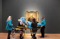 A terminally-ill woman views a painting by Rijksmuseum as her last wish (courtesy Stichting Ambulance Wens)