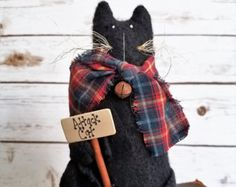 Cleo is a sweet little angel cat who likes to perch up high keeping a safe watch over everyone.  Her best friend Cletus can be found here: https://www.etsy.com/listing/227670411/extreme-primitive-cletus-black-cat-kitty?ref=shop_home_active_1  Cleo is lovingly made from painted and sanded muslin and is filled with fiberfill. She has osnaburg wings and I have hand-stitched her face and given her Thread whiskers. To give her that extreme primitive look, I grunged h...