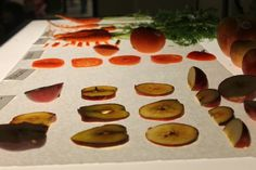 Exploring fruits and vegetables on the light table.