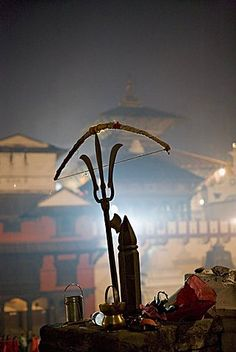 A holy man's bow placed on a bronze sculpture of a Shiva trident, Hindu festival of Shivaratri, Pashupatinath, Kathmandu, Nepal, Asia