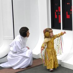 tiny Padme with Princess Leia at Star Wars Disney Weekend.