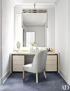 Wolf outfitted a nook of the couple's dressing area with a custom-made mirror and vanity and a slipper chair clad in an Edelman leather.