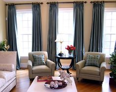 Three window curtains and chairs