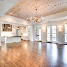 Mid tone floor with white cabinets, open floorplan