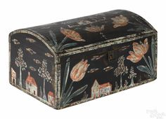 """CBerks County, Pennsylvania painted pine dome lid box, attributed to Heinrich Bucher, ca. 1800, decorated on all sides with houses, churches, and large tulips, 6 7/8"""" h., 13 1/8"""" w., 8 3/4"""" d. Of known Bucher boxes, this example with a dome lid and decoration on all four sides is one of the finest. Provenance: Mrs. Hunt, Orange Street, Lancaster; George W. Scott collection, Christie's, June 10, 1994, lot 530.atalog"""