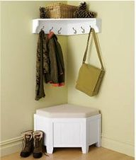 Cute little entryway for a small space. This looks just like our entry way. :)