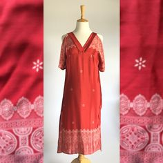 This beautiful red kaftan dress is made in Cape Town from sari fabric. It was designed to make women feel comfortable while looking elegant. It is a fitted dress that is easy and light having a v-neck design that is perfect for the bust and an additional design of two side slits and a cold shoulder.