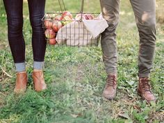 This is a Media Bakery licensable image titled 'An apple orchard in Utah. A couple carrying a basket of apples.' by artist Mint Images for editorial and commercial use only. No use with out payment. Search our large selection of royalty free and rights managed stock photos.