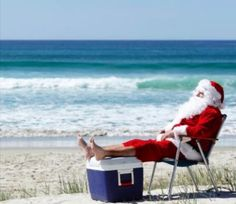 Santa relaxing on the beach