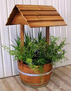 You will love these Wishing Well Garden Planter Feature Ideas and there is plenty of inspiration to get your creative juices flowing! Garden Crafts, Garden Projects, Wishing Well Garden, Wishing Well Plans, Outdoor Crafts, Outdoor Decor, Wine Barrel Planter, Gardening Magazines, Garden Planters