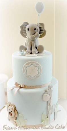 41 Best Baby Shower Cake Ideas to Inspire You. cute elephant giraffe and lion on baby shower cake with blue flower and ribbons around it. Torta Baby Shower, Baby Boy Shower, Safari Baby Shower Cake, Baby Shower Cakes Neutral, Elephant Baby Shower Cake, Baby Cakes, Cupcake Cakes, Cake Fondant, Sweets Cake