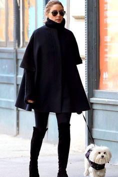 Olivia Palermo wearing Stuart Weitzman 50/50 Boots and Dior So Real Metal and Plastic Sunglasses