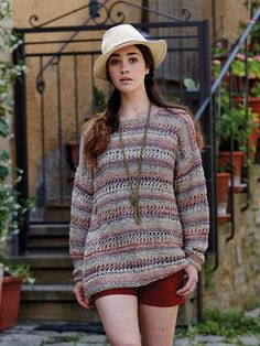 Sorano - Knit this womans openwork slouchy sweater from Rowan Knitting & Crochet Magazine 57, a design by Gemma Atkinson using Pure Linen (100% linen) and Revive (silk cotton and viscose) with a blended textured stripe and long sleeves. This knitting pattern has a two star difficulty rating.