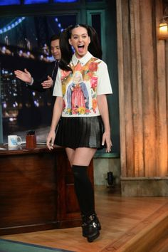Katy perry in a short black girly skirt and what so ever the name of shirt