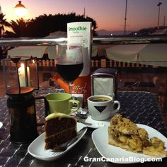 The Lighthouse Arguineguin Breakfast Brunch and Tapas in Gran Canaria: Carrot cake, apple pie, tea coffee and wine with a view of Mt.Teide