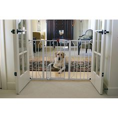This walk through pet gate is perfect for keeping your pet in a determined space. The extra wide gate boasts a convenient walk-through door and safety lock. This gate is easy to assemble with its pressure mounted, expandable construction.