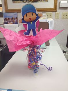 Pocoyo center piece Recycled Starbucks bottle, tissue paper, and ribbon all for less than $1.00 :)