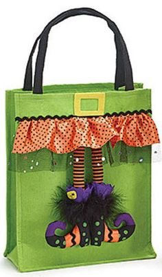 Large Halloween felt bag assortment with dangling witch legs and satin printed skirts. Witch shoes are black with swirl and dot accents. Colors include: purple, green, and X 10 Total with handles: Gusset: 5 Dulceros Halloween, Bonbon Halloween, Adornos Halloween, Halloween Ornaments, Diy Halloween Trick Or Treat Bags, Halloween Candy Bags, Halloween Goodies, Halloween Sewing Projects, Witch Legs