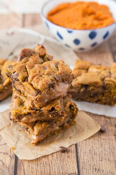 These Pumpkin Caramel Cookie Bars are sinfully good! Chewy Pumpkin cookie dough…