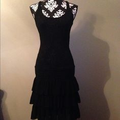 ♣️Black mesh Rugby by Ralph Lauren dress.♣️ ✔️Black Rugby by Ralph Lauren fitted dress. See through. Racer back.This dress is a small but it also  stretches so I'm sure it can fit a medium too. Has 3 layers of ruffles on bottom. Third picture shows material and the shimmer the best. Personally, I think it would be very cute on a boat ⛵️, beach , or for night life with some type of slip or not! Lol Ralph Lauren Dresses