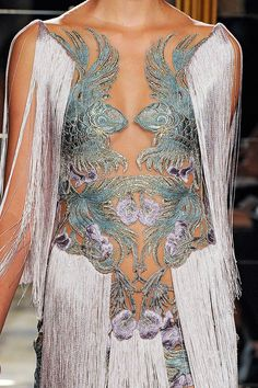 Marchesa.  I'm not actually mad about this, but the koi (or is it dragon?) embroidery is amazing.