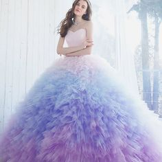 This dreamy pastel ombre gown from Kiyoko Hata is taking our breath away! #weddingdress #gown #fairytale #princess #lavender #blue #purple #ruffles #ballgown #wow #beautiful #praisewedding