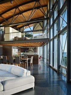 Seattle Residence by Lawrence Architecture curved roof and lots of glass.