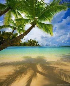 Island getaway summer blue sky beach ocean water clouds trees