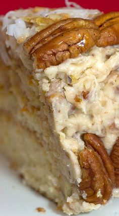 Fresh Orange Italian Cream Cake ~ It is spectacular... It's filled with pecans and flaked coconut, and the cake itself is moist and delicious...with cream cheese icing to finish it all off.