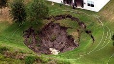 PHOTO: A sinkhole that opened up May 3, 2012, behind a Windermere, Fla. home has grown to about 100 feet wide and 50 feet deep.