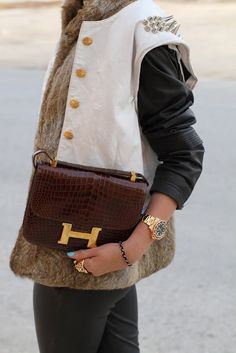 Leather jacket: DKNY  Fur vest: Michael kors  Leather vest: Vintage  Pants: Topshop  Bag: Hermes  Watch: Rolex  Ring: Cartier