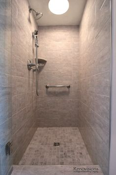 Bathroom remodel by Renovisions. Contemporary style, chrome fixtures, walk-in shower, tile shower, hand held shower, glass shower door