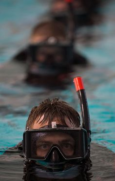 Search and rescue swimmers learn basic rescue techniques. by Official U.S. Navy Imagery, via Flickr