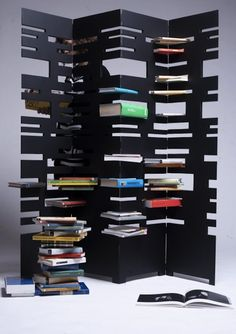 Tower Bookcase Unfolds into A Dividing Screen