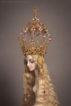 Virgin: Doll features a one of a kind, sterling silver crown with a 24k gold plate and a new, limited edition face design in the style of Italian Renaissance painting, particularly that of Leonardo Da'Vinci. This project is also heavily inspired by religious art, especially the imagery of Virgin Mary, who is frequently portrayed as a fragile and radiant crowned creature. by Marina Bychkova