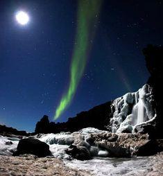 Öxarárfoss in Iceland – Aurora Borealis taken by Arnar Valdimarsson.