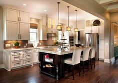 The kitchen inside the new custom model home by Wedgewood Building Company at Grandin Hall in Carmel, Ind.
