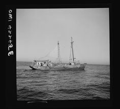 """On board a fishing vessel out from Gloucester, Massachusetts. A Nantucket dragger, or New England type otter trawler, the """"Theresa and Dan""""(?) Photographer Howard Liberman Created September 1942"""
