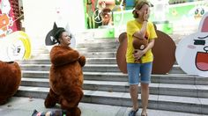 Mr Alex Wee surprised his girlfriend Cheryl Foo with a wedding proposal while disguised in a bear mascot costume. http://www.straitstimes.com Photo: Ong Wee Jin/The Straits Times