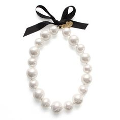 Miss Piggy's Pearls    Miss Piggy's Pearl Neckalce.    Necklace is made of resin pearls attached on a string and a black sash to tie. The Muppets    $105.00